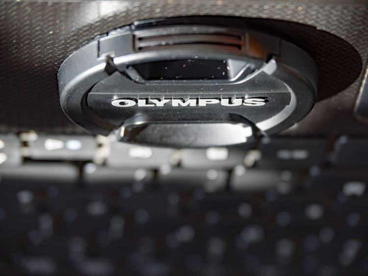 Inverted Lens cap Alphabet Close-up Communication Day Film Industry Indoors  Keyboard Computer Lenscap Metal No People Technology Text