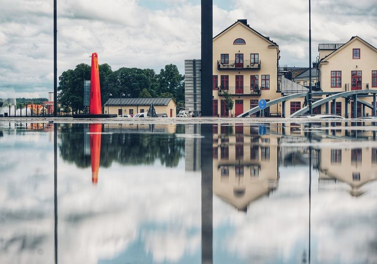 Puddle 2019 Niklas Storm Juni City Water Reflection Sky Architecture Building Exterior Built Structure Cloud - Sky Urban Skyline Settlement Downtown District The Architect - 2019 EyeEm Awards My Best Photo