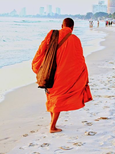 Monk. Beach Sand Adult Full Length One Man Only Rear View Traditional Clothing Sea Travelling Thailand BUDDHISM IS LOVE Adults Only One Person People Men Monk  Sky Yellow Color Tranquil Scene Outdoors Travel Destinations Spirituality Beauty In Nature Low Angle View Landscape Travel