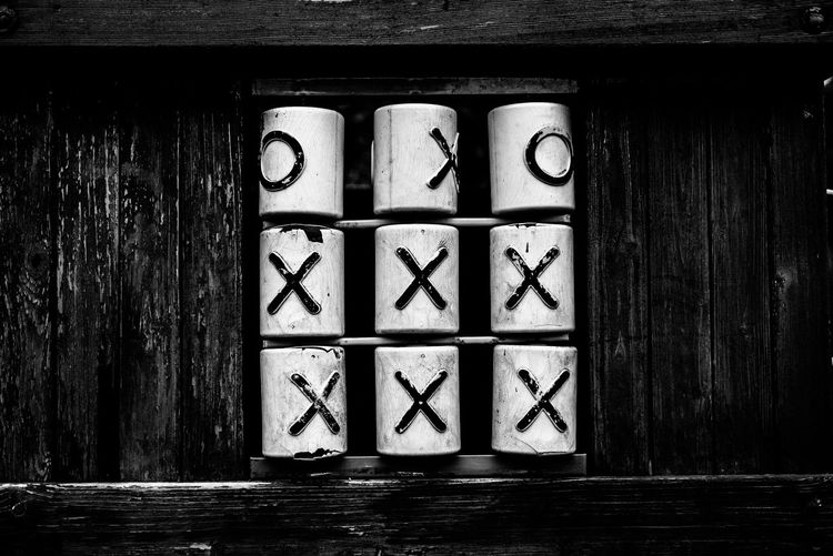 Stack Of Cups With Alphabets On Wooden Rack