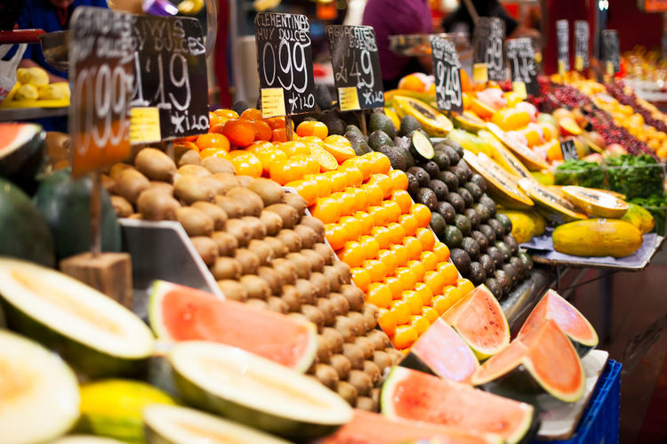 market of fruits in Barcelona Abundance Choice Food Food And Drink For Sale Freshness Fruit Healthy Eating Large Group Of Objects Market Market Stall No People Orange Orange Color Price Tag Retail  Selective Focus Still Life Variation Vegetable Wellbeing