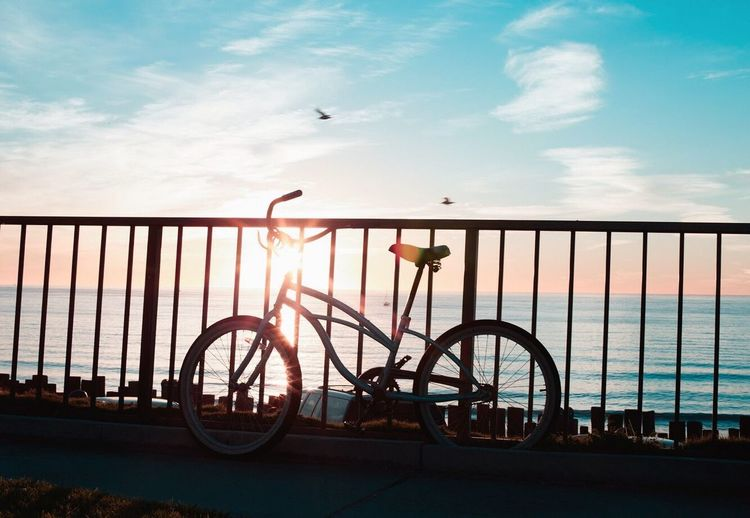 Sky Railing Transportation Bicycle Mode Of Transport Cloud - Sky Sea Land Vehicle Sunset Built Structure Water Architecture Day Sunlight Nature Building Exterior Outdoors No People Horizon Over Water