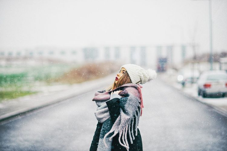 Woman on road in city during winter