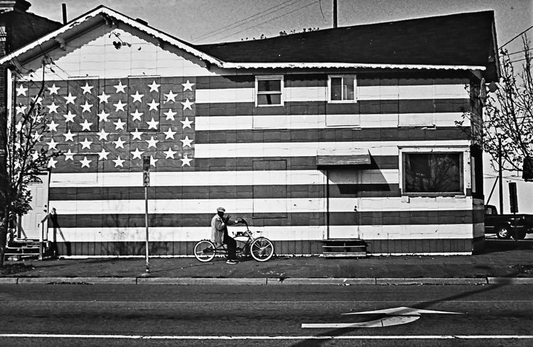 Architecture Bicycle Building Exterior City City Life Day Flag Full Length Land Vehicle Men Mode Of Transport On The Move Outdoors Riding Road Saginaw Side View Street Sunny Transportation Travel