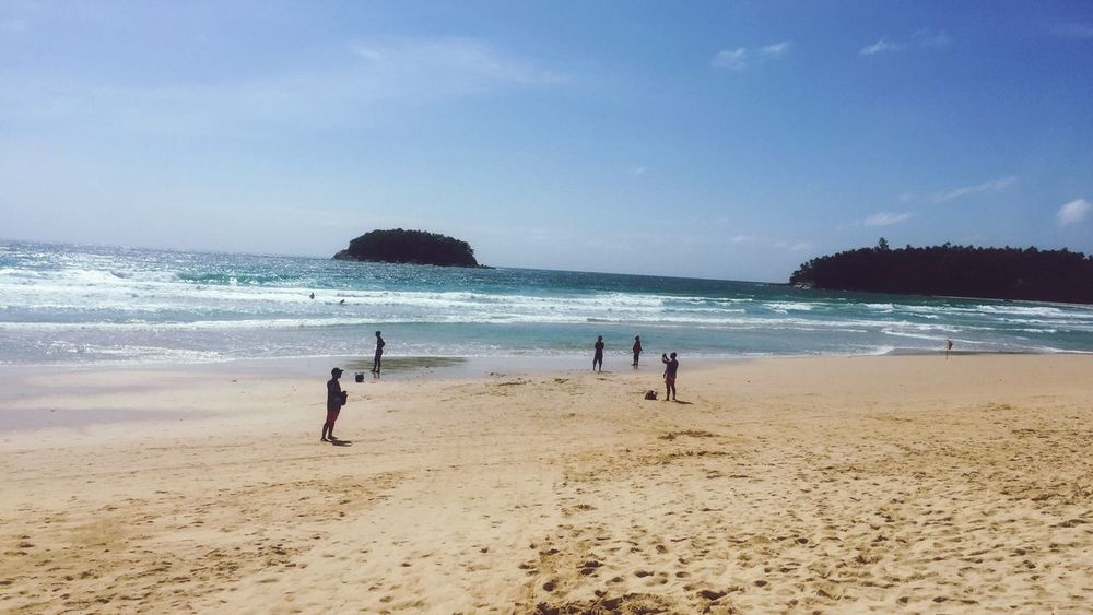 Travel Destinations Sea Water Vacations Beach Sand Shore Surf Sky Unrecognizable Person