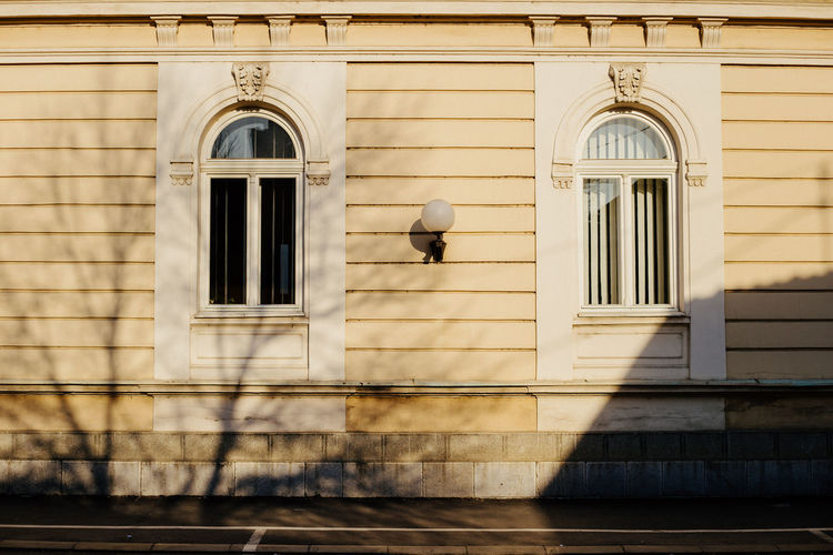 A wall of a beautiful building illuminated by sun