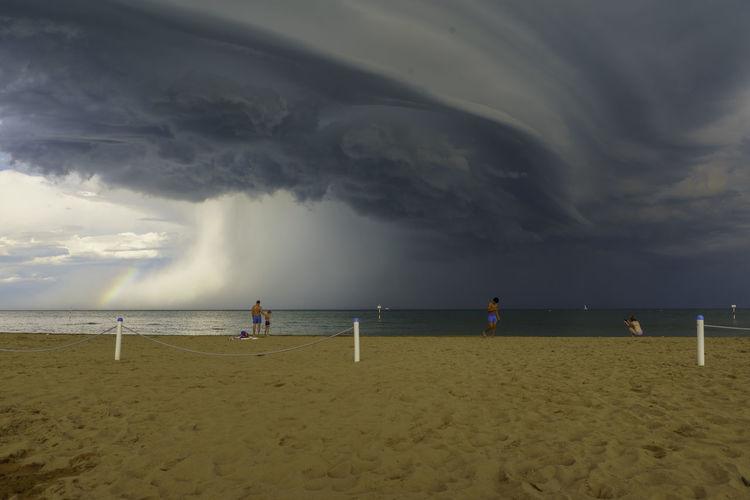 Stormy weather Water Sea Beach Child Sand Full Length Sport Sky Horizon Over Water Thunderstorm Storm Cloud Lifeguard  Dramatic Sky Hurricane - Storm Cyclone Meteorology Torrential Rain