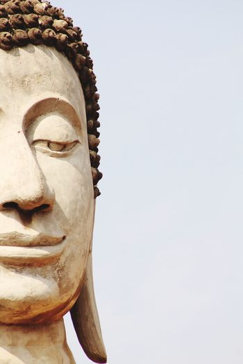 Close-up of statue against temple against clear sky
