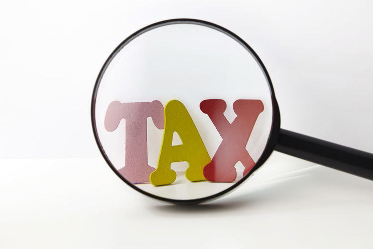 magnifying glass and word tax Alphabet Budget Enlarge Government Research Word Close-up Focus Income Indoors  Magnifier Magnifying Glass No People Saving Searching Still Life Studio Shot Tax Transparent White Background