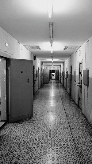 Prison Prison Jail Cell Cellblock Doors Blackandwhite Black And White Hallway Room Captured Hopeless Corridor Floor Heavy Neon Lights Inside Interior Lonely Loneliness Isolated Claustrophobic Monochrome Feel The Journey Capture Berlin