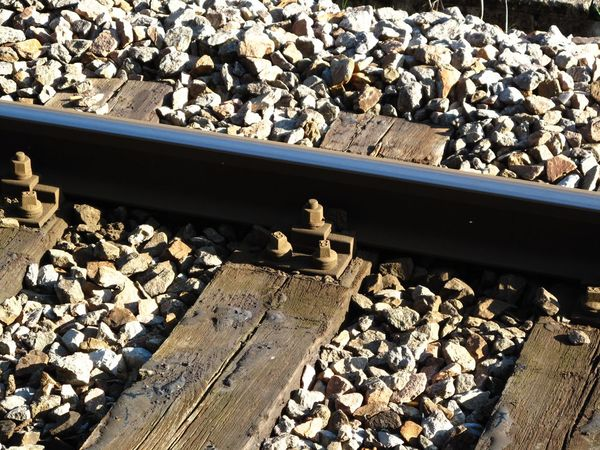 Close-up Day Gravel High Angle View No People Outdoors Pebble Rail Transportation Railroad Track Rock - Object Shadow Stone - Object Sunlight Transportation