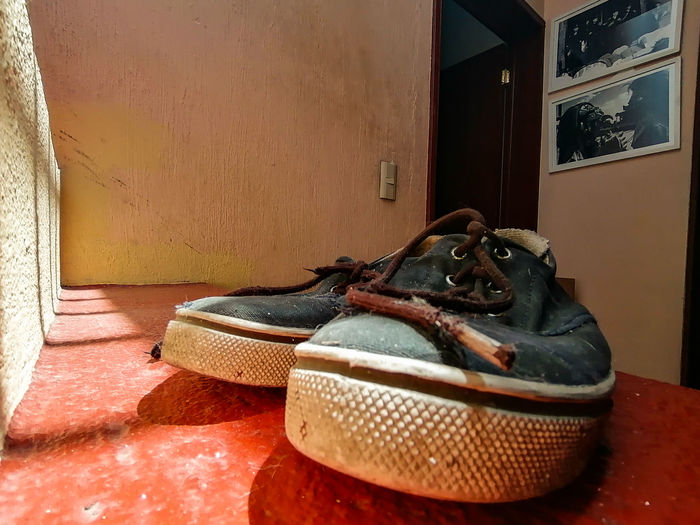 High angle view of shoes on floor against wall at home