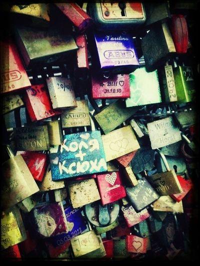 Love locks on the Hohenzollern Bridge crossing the river Rhine in Cologne