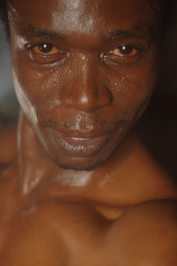 Portrait Of Shirtless Man With Sweat Covered Face