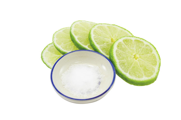 Lime sliced with salt. isolated on white background. Clipping path. Alcohol Citrus Fruit Close-up Day Drink Drinking Glass Food Food And Drink Freshness Frothy Drink Fruit Indoors  Lemon Lime No People Refreshment Shot Glass SLICE Studio Shot Tonic Water White Background