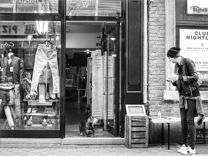 Welcome! Please come in! The Street Photographer - 2018 EyeEm Awards Blackandwhite Photography Black And White Street Photography Dog Strangers Store Door