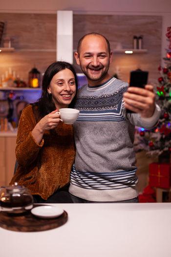 Man and woman looking at camera