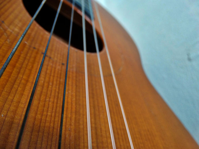 Guitar close-up. Musical Instrument Music Musical Equipment String String Instrument Musical Instrument String Arts Culture And Entertainment Close-up Guitar No People Wood - Material Indoors  Acoustic Guitar Still Life Focus On Foreground Detail Brown High Angle View Skill  Parallel Instrument