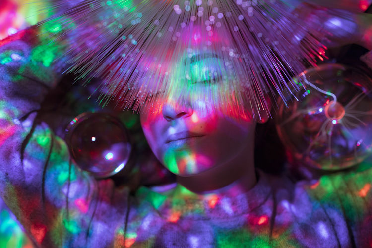 Multi Colored Headshot One Person Illuminated Portrait Indoors  Eyes Closed  Adult Light - Natural Phenomenon Young Adult Motion Studio Shot Nightclub Front View Close-up Futuristic Fun Happiness Nightlife Digital Composite Beautiful Woman