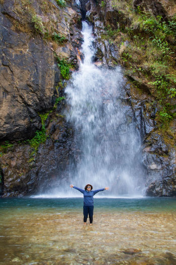 Full length of man standing on rocks