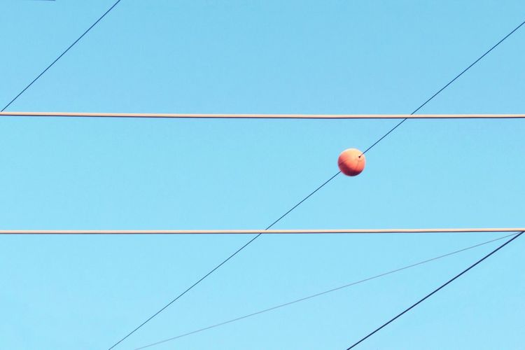 Close-up Angles And Lines City Life Orange Color Simplicity Minimalism Minimalobsession Urban City Straight Lines Lines And Shapes Urban Geometry Geometry Geometric Shape Cable Low Angle View Blue Clear Sky Hanging Copy Space Outdoors Day No People Sky