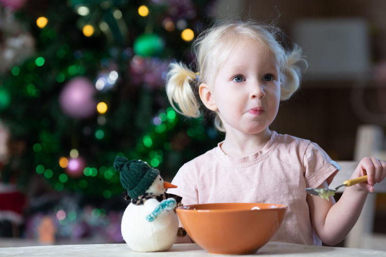 Portrait of cute girl eating food