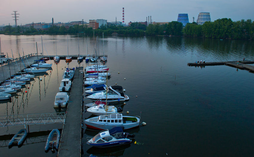 Russia, Yekaterinburg, Upper Iset plant, yacht club Abundance Boat Canal City City Life Day Harbor In A Row Mast Mode Of Transport Nature Nautical Vessel No People Outdoors River Russia, Yekaterinburg, Upper Iset Plant, Yacht Club Side By Side Sky Water Wooden Post