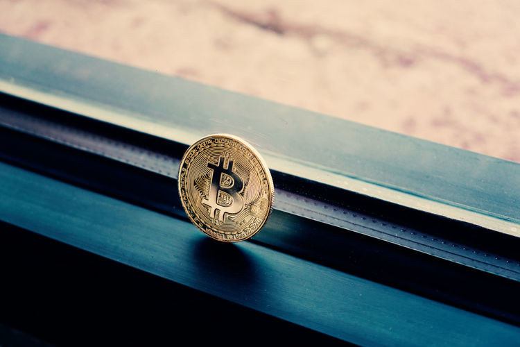 Bitcoin cryptocurrency for current business finance. Currency Technology Everywhere Bitcoin Block Chain Circle Close-up Coin Cryptocurrency Currency Symbol Current Design Digital Currency Finance Focus On Foreground High Angle View Metal No People Selective Focus Shape Still Life Sunlight Technology