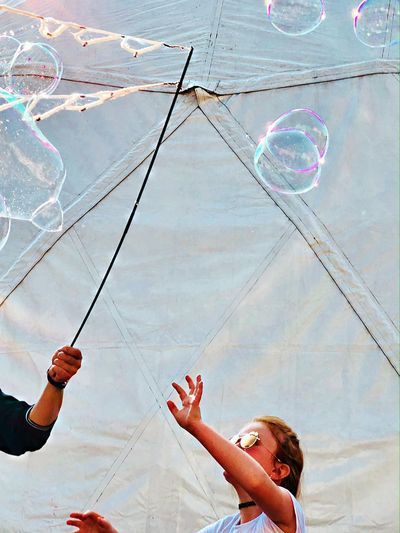 Low angle view of woman with bubbles