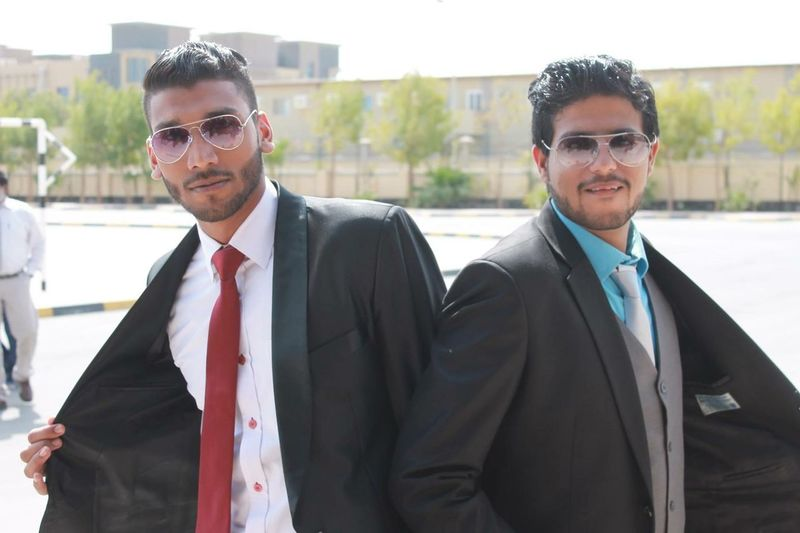 Portrait Of Businessmen Wearing Suit While Standing In City