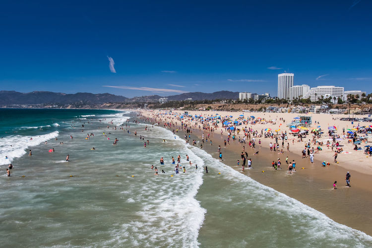 Santa Monica beach Beach California City Life Coastline Crowd Day Enjoying Life Fun Large Group Of People Leisure Leisure Activity Lifestyles Mixed Age Range Ocean Outdoors Summer The Essence Of Summer People And Places Travel Travel Destinations Water Waves Landscapes Lost In The Landscape