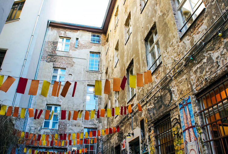 Berlin Travel Traveling Alley Apartment Architecture Art Building Building Exterior Built Structure City Citylife Downtown District Flags Hanging Hot Spot Outdoors Wall Window