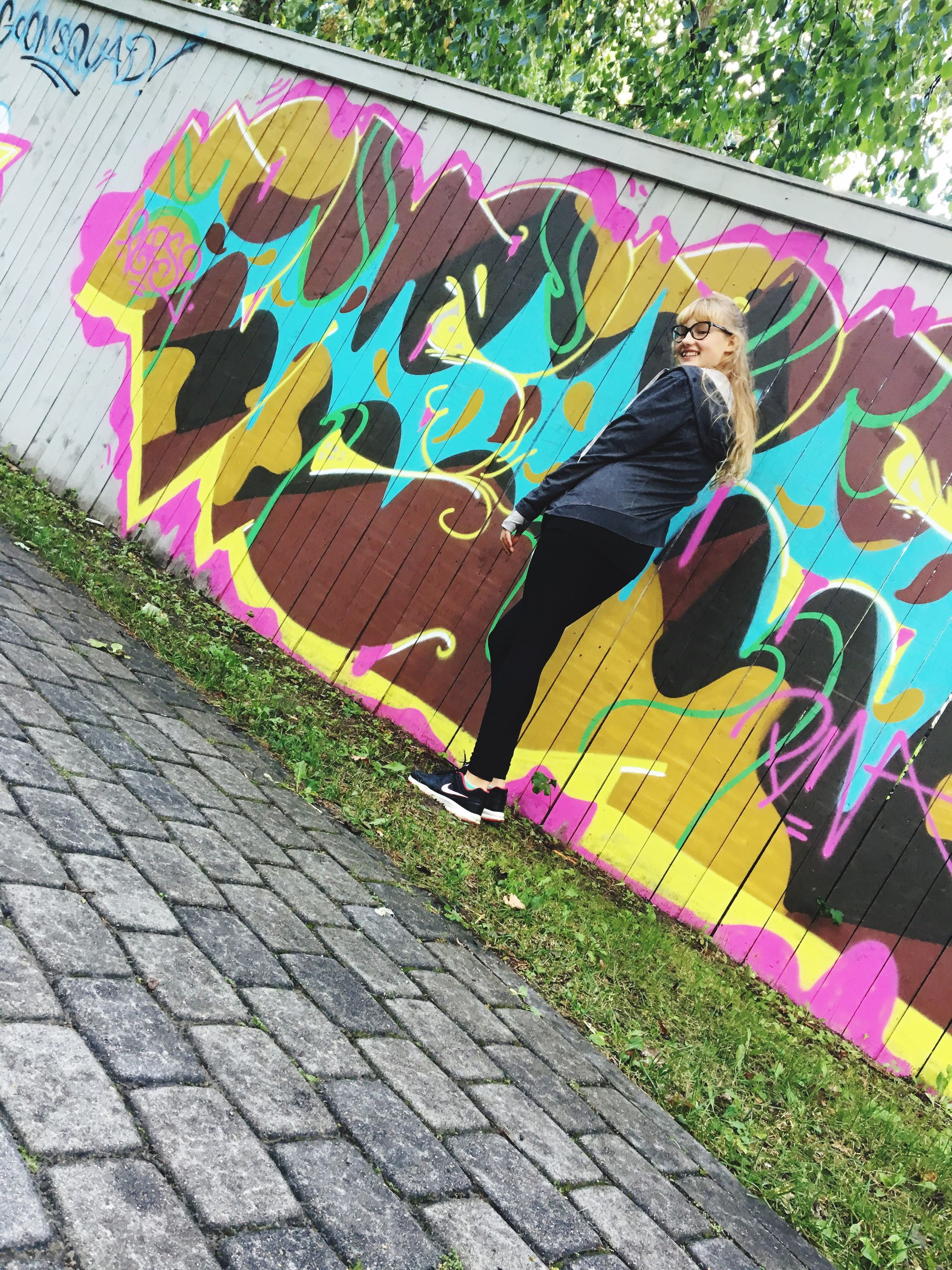 multi colored, graffiti, art and craft, art, full length, creativity, colorful, outdoors, person, curve, footpath, vibrant color