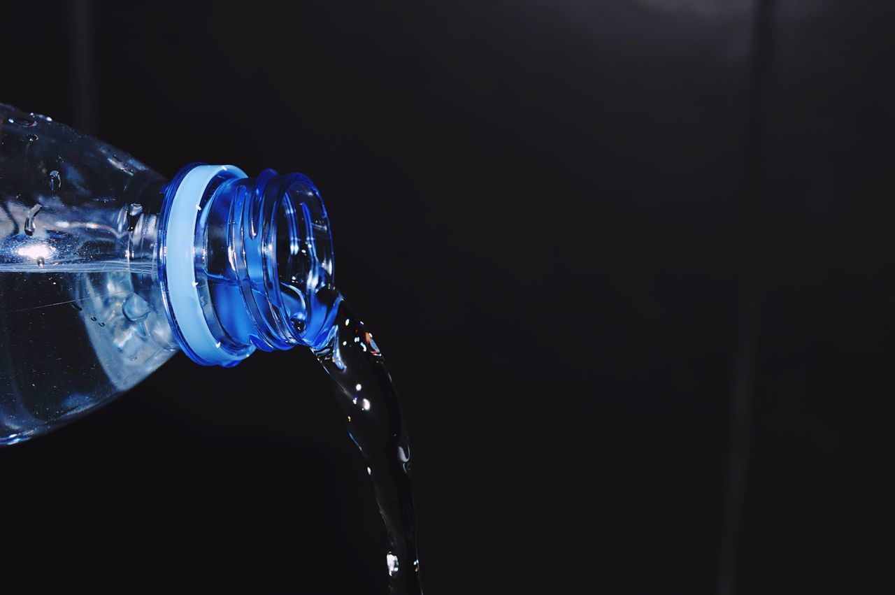 Water Pouring Out Of Bottle