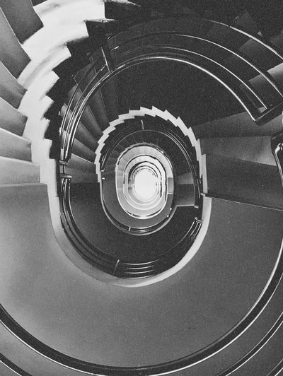Enter the void Analogue Photography Analog Steps And Staircases Spiral Staircase Staircase Spiral Indoors  Architecture High Angle View Railing Built Structure No People Shape Geometric Shape Circle Pattern Diminishing Perspective Design Directly Above Full Frame Directly Below Concentric