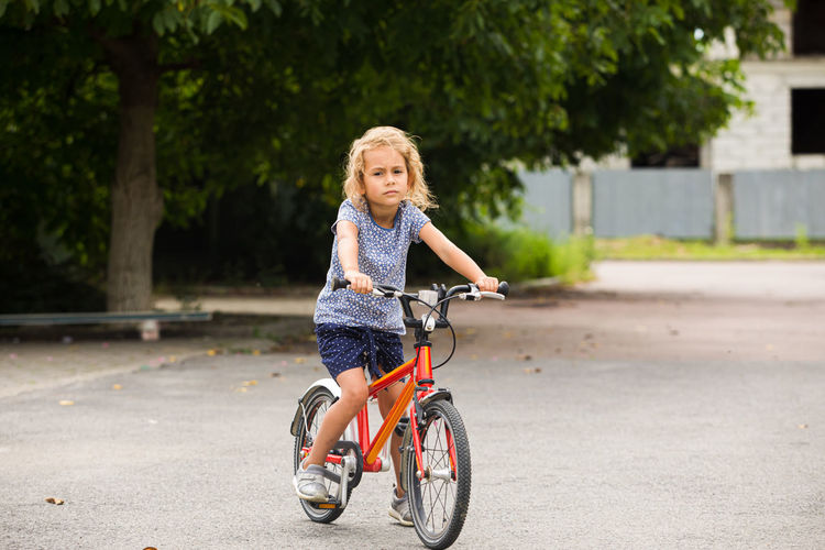 Portrait of girl riding bicycle