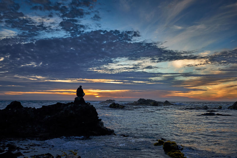 Sunset silhouette... Nature Tranquil Scene Orange Color Non-urban Scene Land Silhouette Rock - Object Sea Water Rock Beauty In Nature Scenics - Nature Sky Sunset Cloud - Sky Horizon Over Water Solid Tranquility Idyllic Outdoors Scenics Seascape Aroundtheworld Tourism Nature