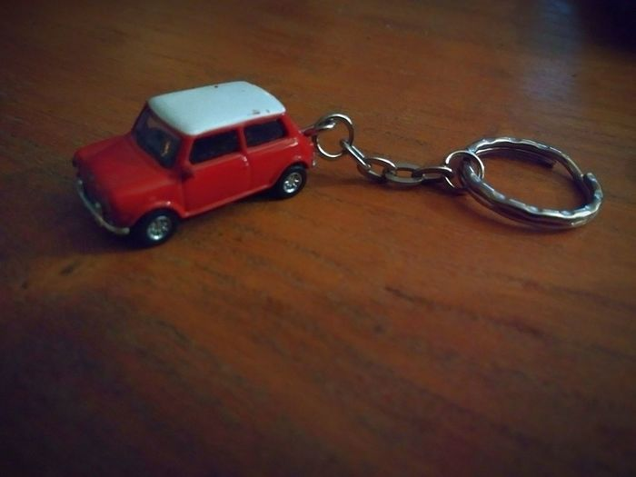 A very mini cooper Mini MiniCooper Keyring Fast Faster Red White Redandwhite Chain Ring Ringchain Exposure Lighting Wood Table Wooden Table Gotwood Woodgood GoodWood Cooper Minicoop Minicar ToyCar Table Close-up Key Ring Chain Wooden Still Life Single Object Metal