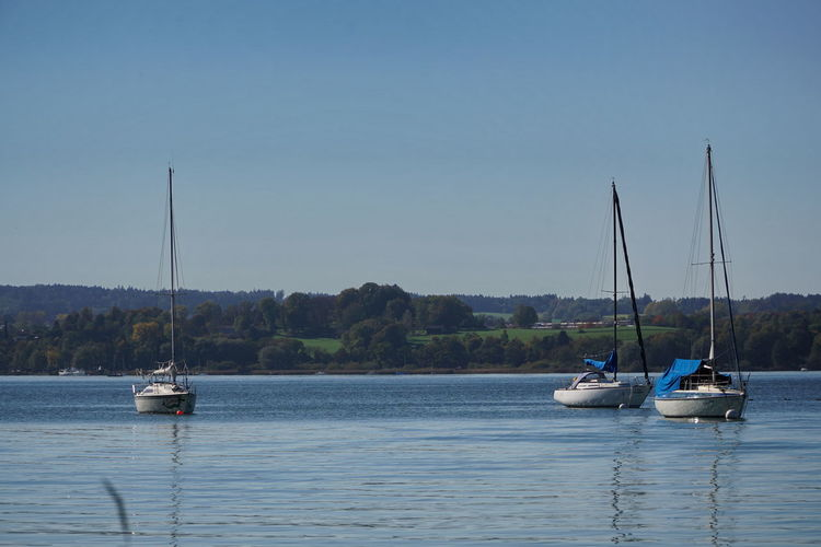3 sailboats Nautical Vessel Water Transportation Mode Of Transportation Sky Sailboat Mast Waterfront Pole Sailing Nature Sea Scenics - Nature Beauty In Nature Day Clear Sky Tranquility Tranquil Scene Outdoors No People Yacht Lake Ammersee Ammersee Breitbrunn Time Off