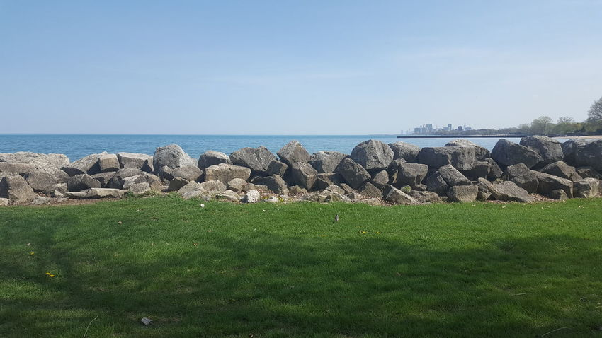 Lakefront Land Water And Sky Beauty In Nature Horizon Over Water Lakeshore Rocks On The Shore Scenics - Nature Tranquility