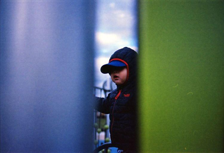 Cute Boy Seen Through Outdoor Play Equipment At Playground