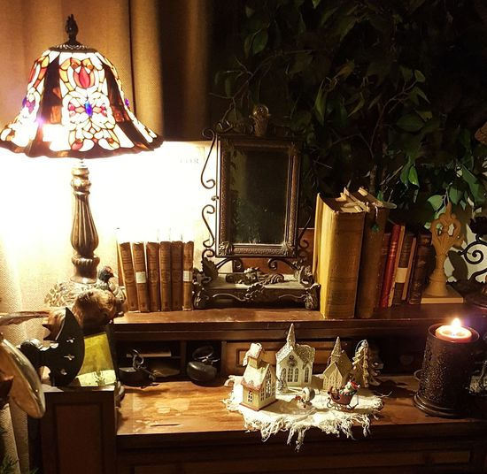 Which Item Does Not Belong? Electric Lamp Home Interior Illuminated Table Antiques Antique Desk Antique Books Cozy At Home Cozy And Warm Cozy Winter Collecting Collectibles Tiffany Lamp Candelight Mirror Indoors  No People Chair Day Home Decoration  Home Decorating Vintage Furniture