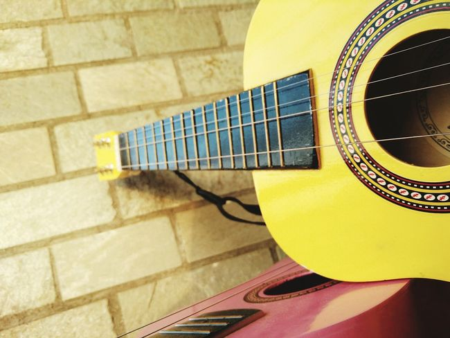 Guitar Music Musician Instrument Whole Yellow Color Pink Broken Wall Shapes Lines Reflection Beauty Art Yellow Architecture Close-up Built Structure