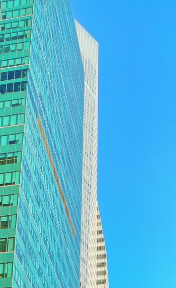 Architecture Blue Building Exterior Sky Low Angle View Clear Sky Skyscraper Modern Built Structure No People Pattern Outdoors Day City Close-up Minimalistic Minimalist Architecture