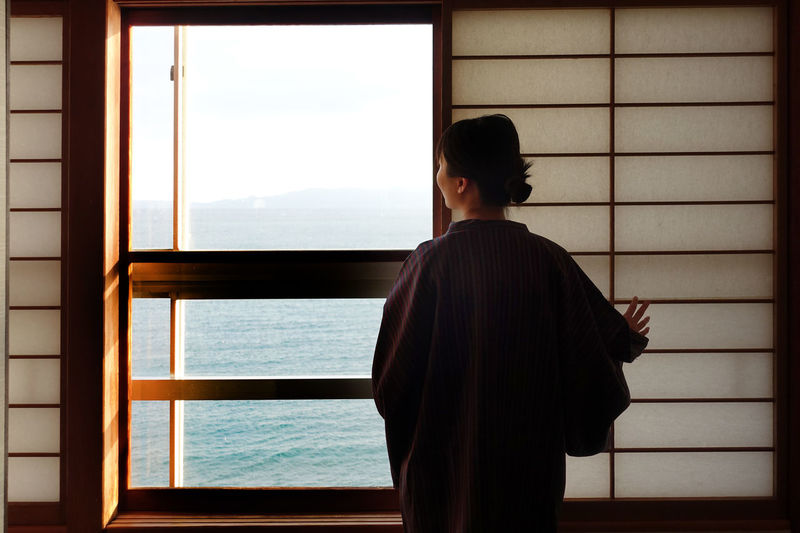 By The Sea Escaping Holiday Housewife Morning YUKATA Adult By The Window Lifestyles Real People Sea Standing Washitsu Window Fresh On Market 2018