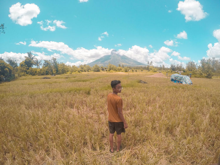 Mayon Active Volcano Adventure ASIA Beauty In Nature Boy Camoflauge Farm Field Landscape Landscape Photography Mayon Volcano Daraga, Albay Philippines Men Mountain Nature One Person Outdoors Perfect Cone Volcano Philippines Rear View Rice Field Sky Standing Tourism Travel Volcano
