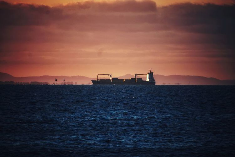 Ship In Sea Against Sky During Sunset