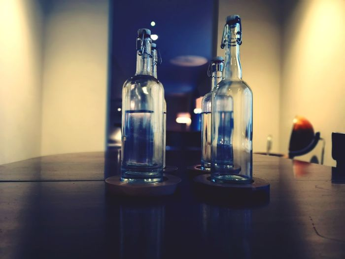 Close-up of bottles on table at restaurant
