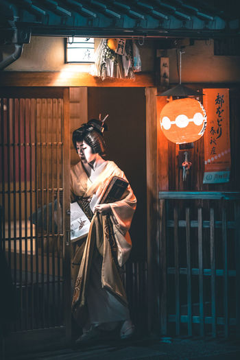 Walking through the streets of Kyoto at night. A city full of tradition and such beauty. Geisha Japan Japan Photography Japanese Culture The Street Photographer - 2018 EyeEm Awards Tradition Traditional Culture Celebration Clothing Costume Front View Illuminated Indoors  Leisure Activity Lighting Equipment Night One Person Real People Spooky Standing Street Streetphotography Traditional Women Young Adult The Traveler - 2018 EyeEm Awards