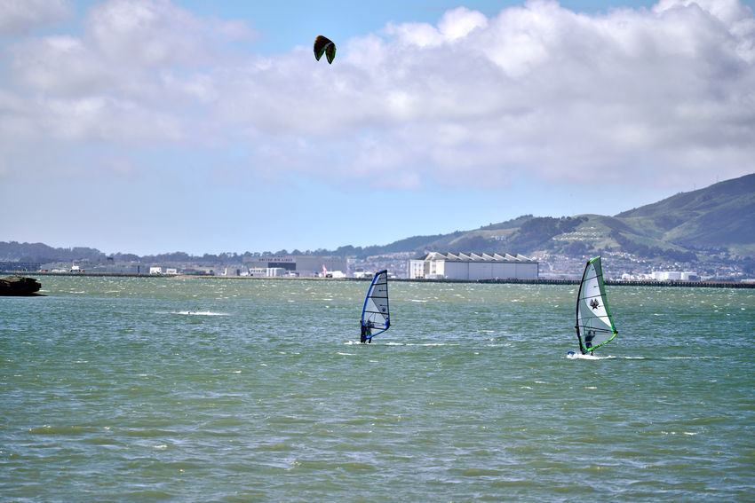 Windsurfing At Coyote Point 2 The Color Of Sport Windsurfers Kiteboarder Riding The Winds Coyote Point San Francisco Bay Marin Headlands San Francisco Shore SFO Airport Windsurfing Kiteboarding A Day On The Bay Enjoying Life Sports Photography Landscape_Collection Landscape_photography Sky And Clouds Airport Hanger Cityscape Nature Beauty In Nature Nature_collection Water Mountain Sportsman Water Sport Aquatic Sport Wetsuit